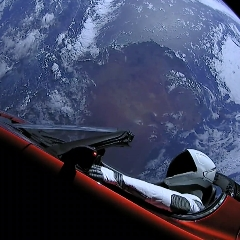 Caption: Starman in his Tesla Roadster bids farewell to Earth after being launched by the first SpaceX Falcon Heavy., Credit: SpaceX