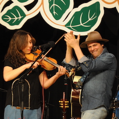 Caption: Ruth Ungar and Mike Merenda of The Mammals on the WoodSongs Stage.