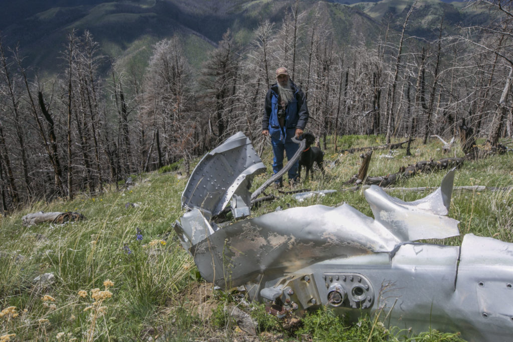 Caption: Bryan Wells, finder of the wreakage, with some of what's left on Emigrant Peak, Credit: Adrian Sanchez Gonzalez/Bozeman Daily Chronicle