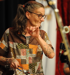 Caption: The amazing Abby the Spoon Lady on the WoodSongs Stage.