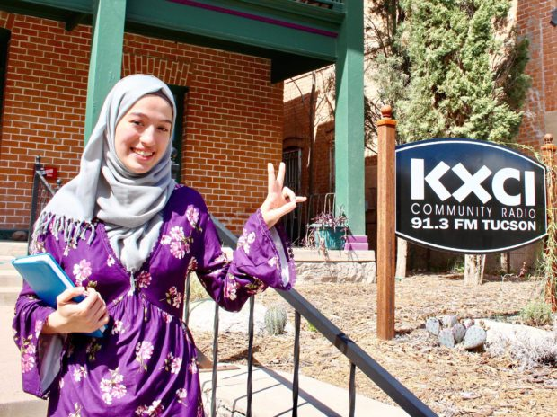 Caption: ouda in front of KXCI–photo by her teacher Christina