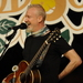 Caption: Chris Barron on the WoodSongs Stage.