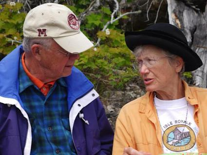 Caption: IRFFA members Grant Merrit and Sally Connoly visiting at an Island gathering., Credit: Isle Royale Families and Friends Association