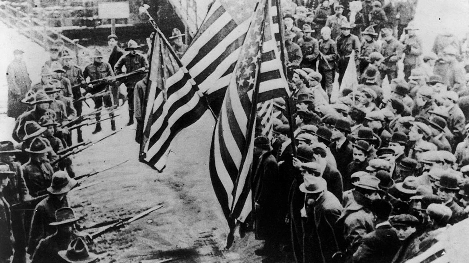 Caption: Massachusetts militiamen with fixed bayonets surround a group of peaceful strikers (1912 Lawrence textile strike)