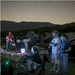 Caption:  At the Lake Henshaw Overlook preparing for the Pluto occultation with an Unistellar eVscope prototype and a large Celestron C14 telescope. From left to right: Martin Costa, Franck Marchis, Joana Oliveira Marques and Mat Kaplan, Credit: Chris Hendren