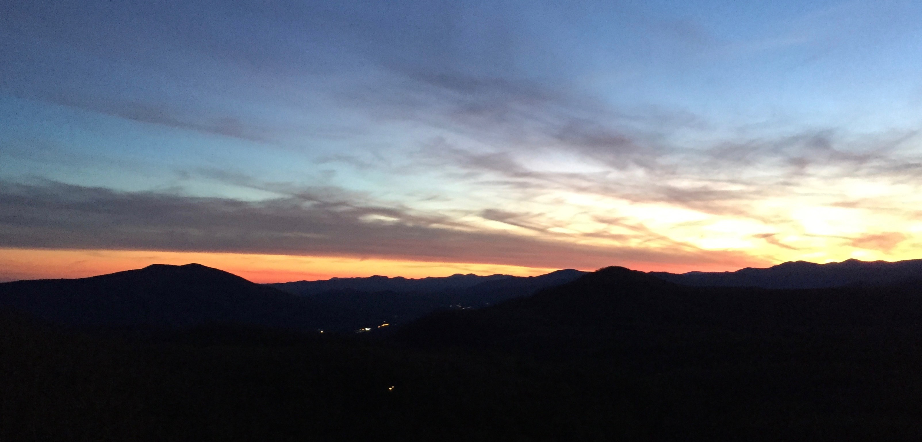 Caption: Sunset over the Blue Ridge Mountains near Little Switzerland, NC. This final weekly Across the Blue Ridge broadcast episode includes a songcatcher story, a feature on a new Highwoods String Band video documentary, and plenty of classic tunes and songs fro, Credit: Paul Brown
