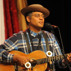 """Caption: """"The American Songster"""" Dom Flemons on the WoodSongs Stage."""