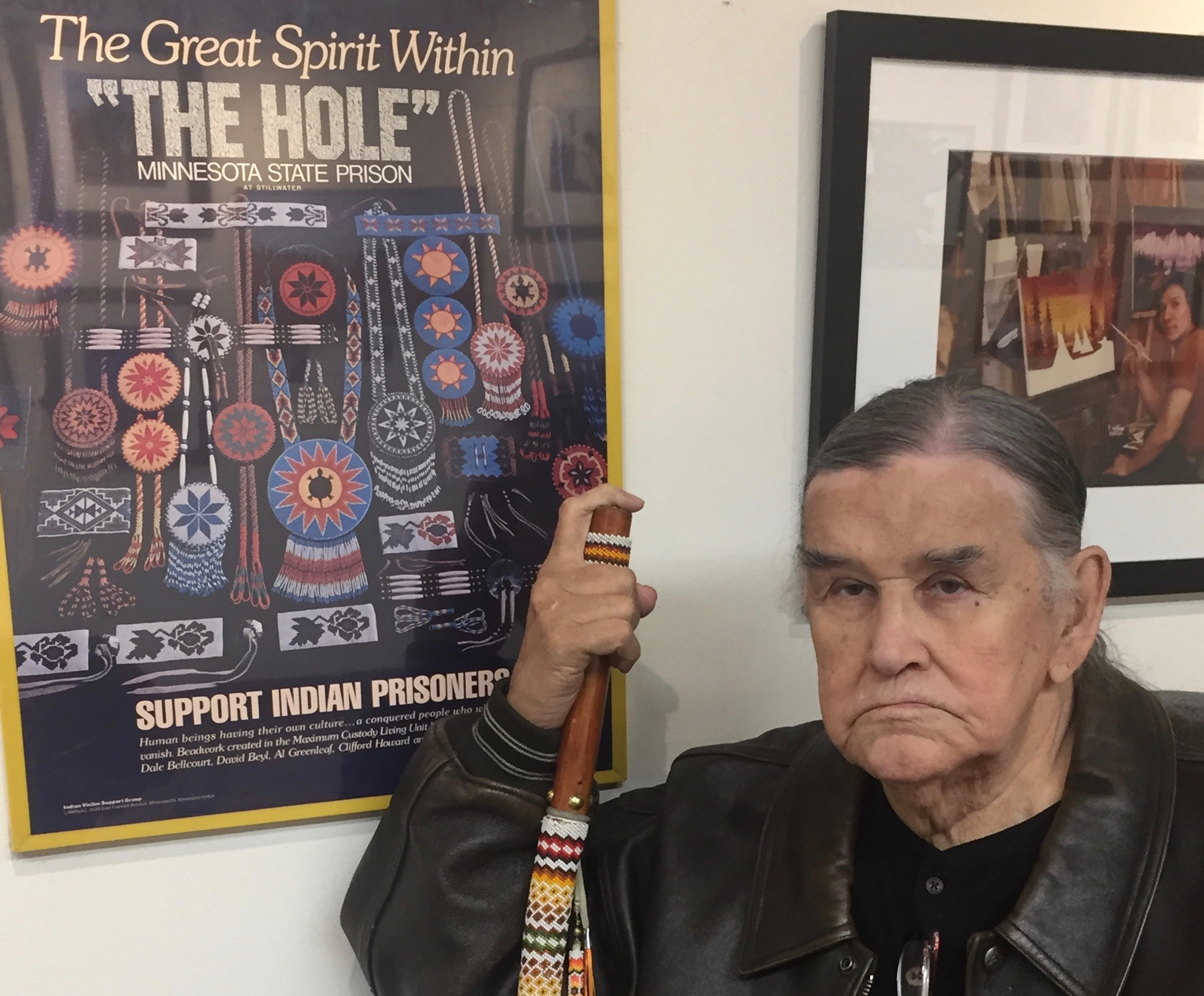 Caption: Clyde Bellecourt sits in front of an exhibit at the AIM Interpretive Center., Credit: Melissa Townsend