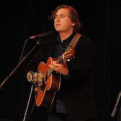 Caption: Master musician and storyteller Joe Crookston.