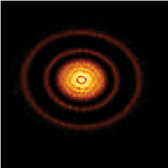 Caption: One of the twenty disks that comprise ALMA's highest resolution survey of nearby protoplanetary disks. This image shows the millimeter-wavelength light emitted by the dust in the disk, giving astronomers a clearer understanding of the similarities and di, Credit: ALMA (ESO/NAOJ/NRAO), S. Andrews et al.; NRAO/AUI/NSF, S. Dagnello