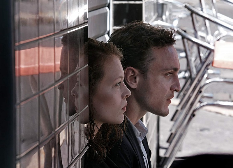 Caption: Paula Beer and Franz Rogowski in 'Transit'