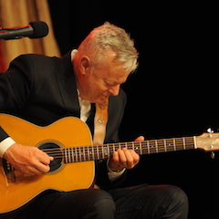 Caption: CGP Tommy Emmanuel on the WoodSongs Stage.