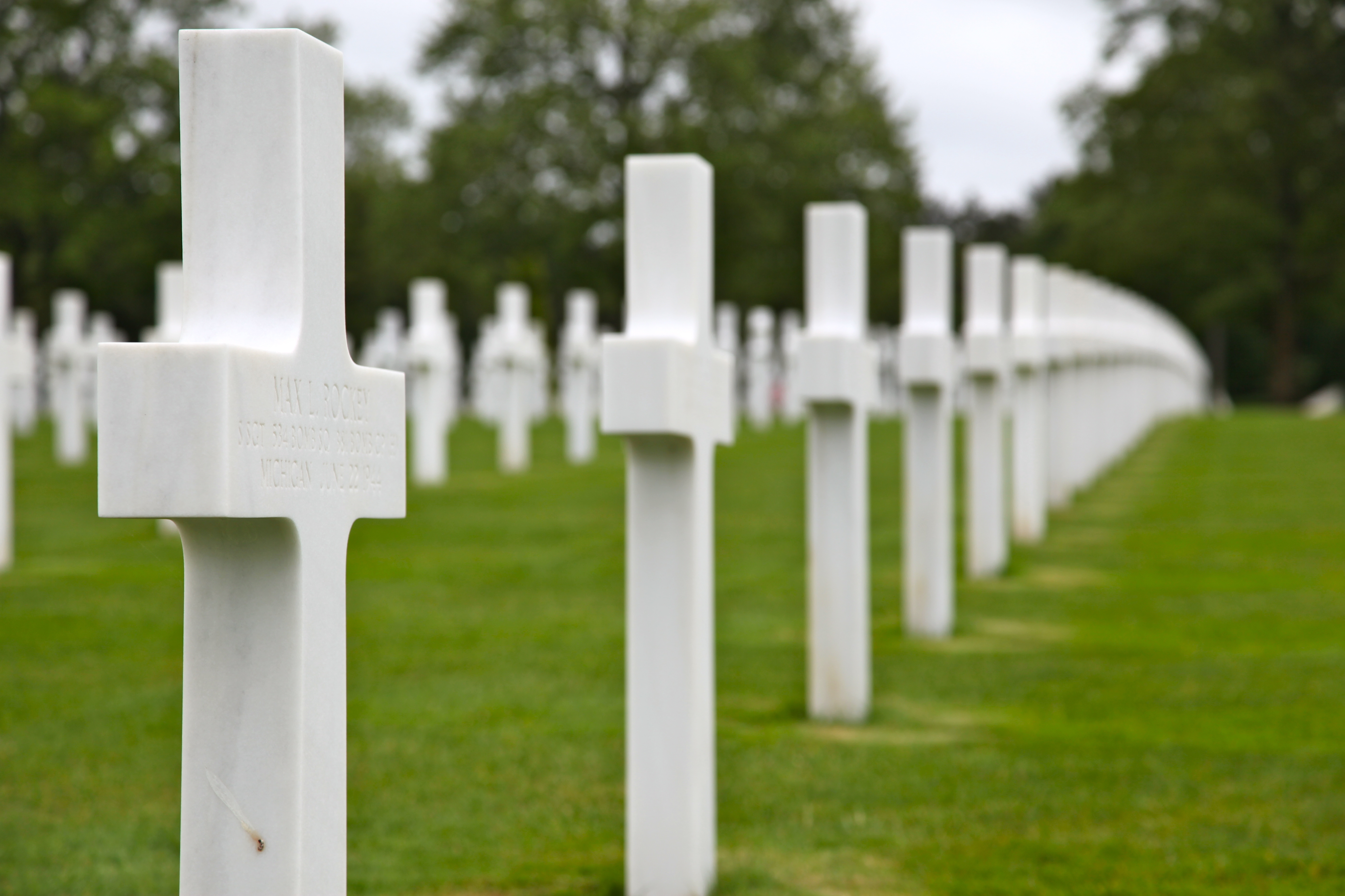 Caption: U.S. Military service members are represented by white headstones for the men that lost their lives during World War II at the American Cemetery, Normandy, France; June 2, 2015. This is the 71st Anniversary of the D-Day invasion of Normandy remembering th, Credit: (U.S. Army photo by Sgt. Austin Berner/Released)