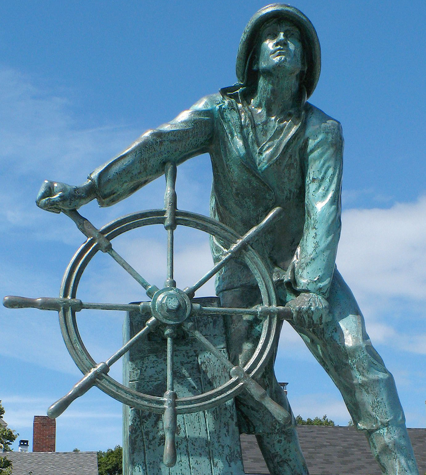 "Caption: The Gloucester Fisherman's Memorial aka ""Man at the Wheel"" is a historic sculpture honoring those lost at sea. Located in Gloucester, Massachusetts and built in 1925. , Credit: Wikimedia Commons"