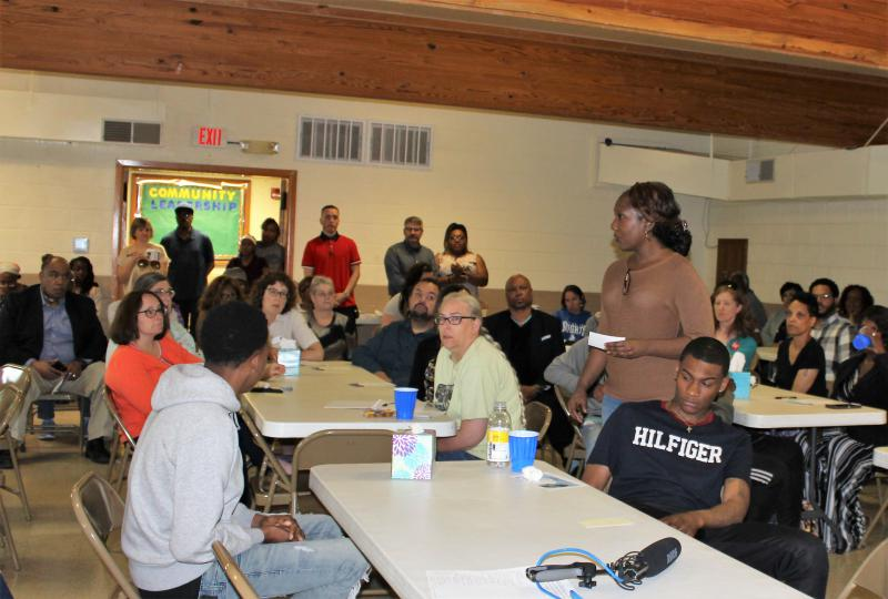 "Caption: Karen Simms speaks to a group gathered on Friday, May 17, 2019, at the Champaign Community Coalition's first ""violence response forum"" at Jericho Missionary Baptist Church in Champaign., Credit: CHRISTINE HERMAN/ILLINOIS PUBLIC MEDIA"