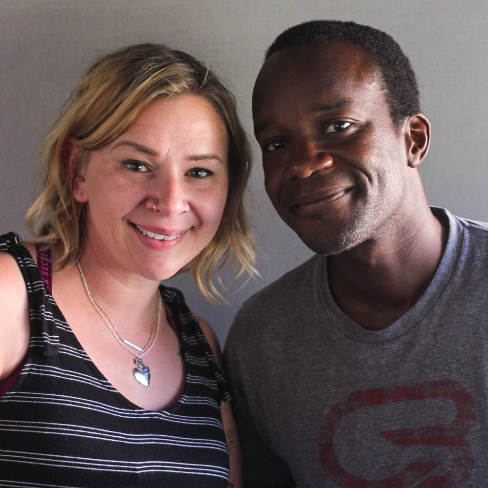 Caption: Tina Dietz and Patrick Conteh at StoryCorps in Bismarck, North Dakota., Credit: By Savannah Winchester for StoryCorps.