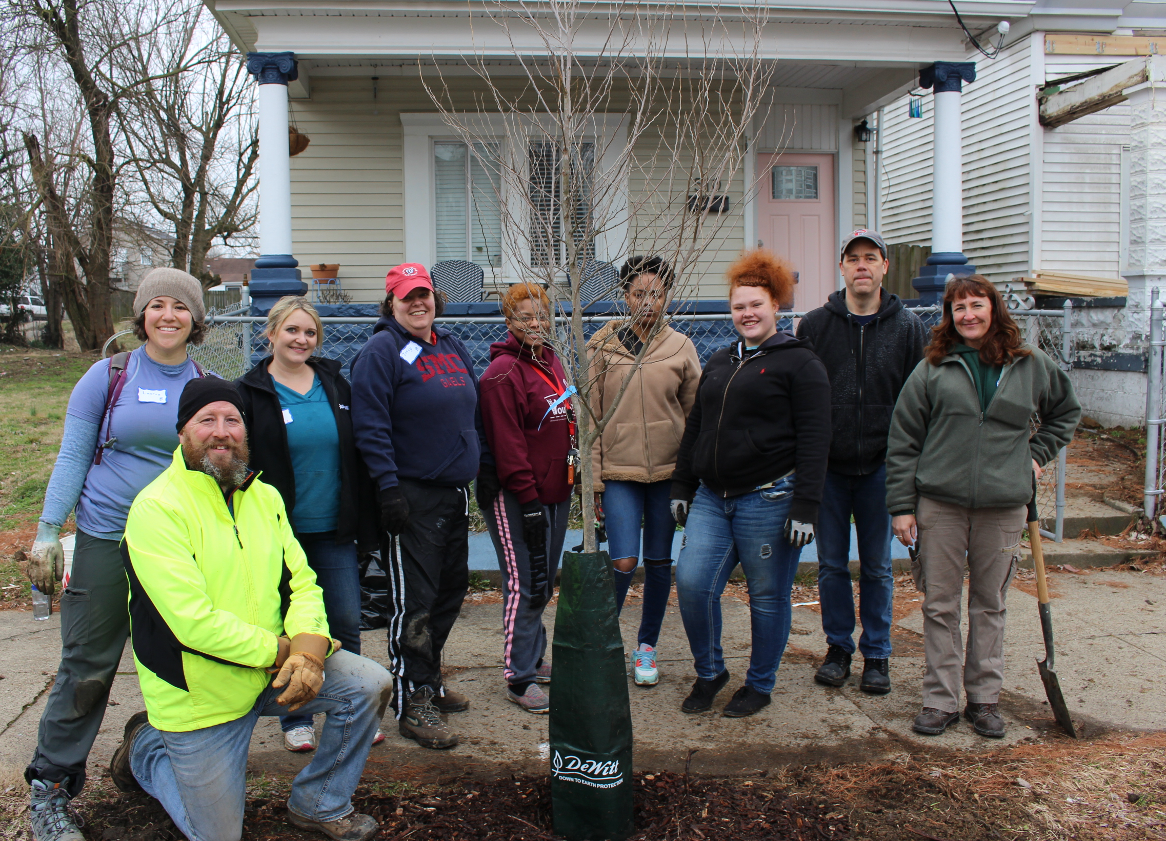 Caption: Volunteers planting trees in Louisville