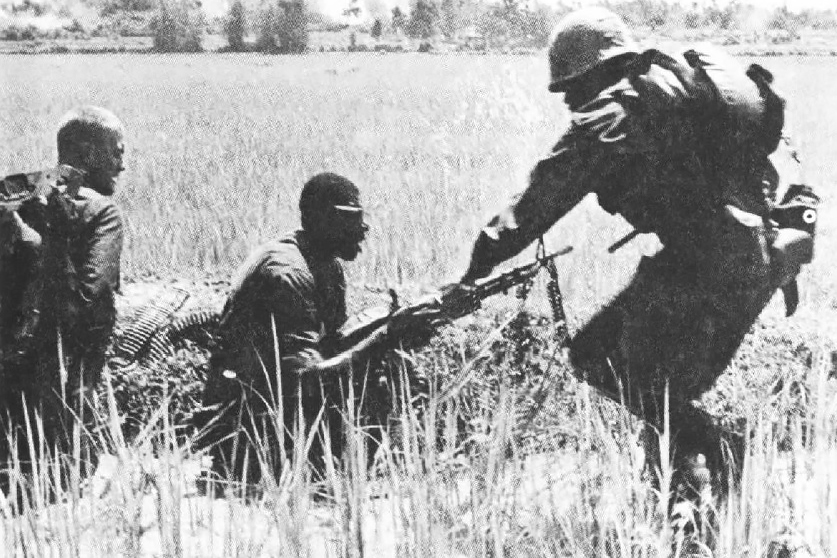 Caption: Black and white Marines served side by side during the Vietnam War, as seen in this 1966 photo of a firefight with the Viet Cong. But racial tension was not uncommon throughout the armed services., Credit: U.S. Marine Corps