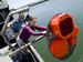 Caption: Kelly Benoit-Bird adjusting the sonar before beginning her experiment., Credit: Nick Kelsh