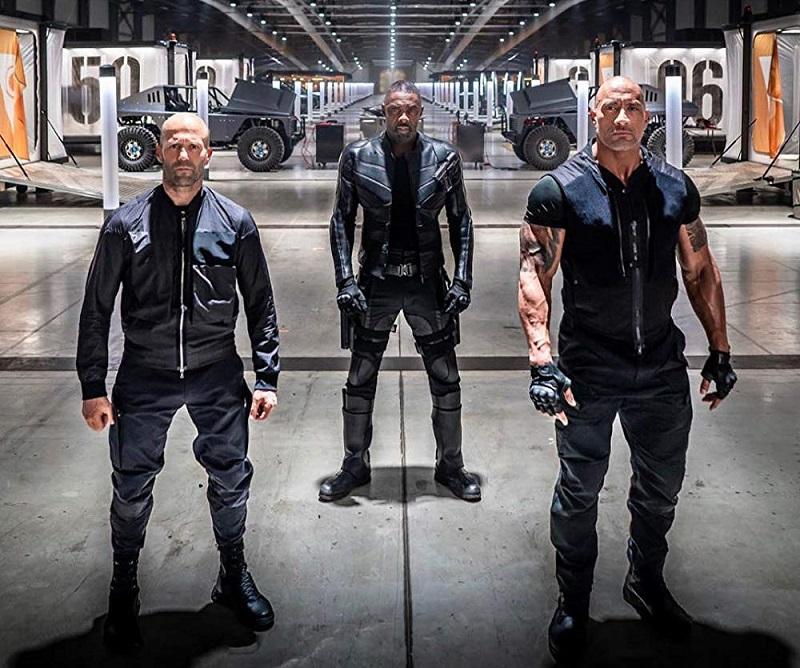 Caption: Jason Statham, Idris Elba, and Dwayne Johnson in 'Fast & Furious Presents: Hobbs & Shaw' (2019)