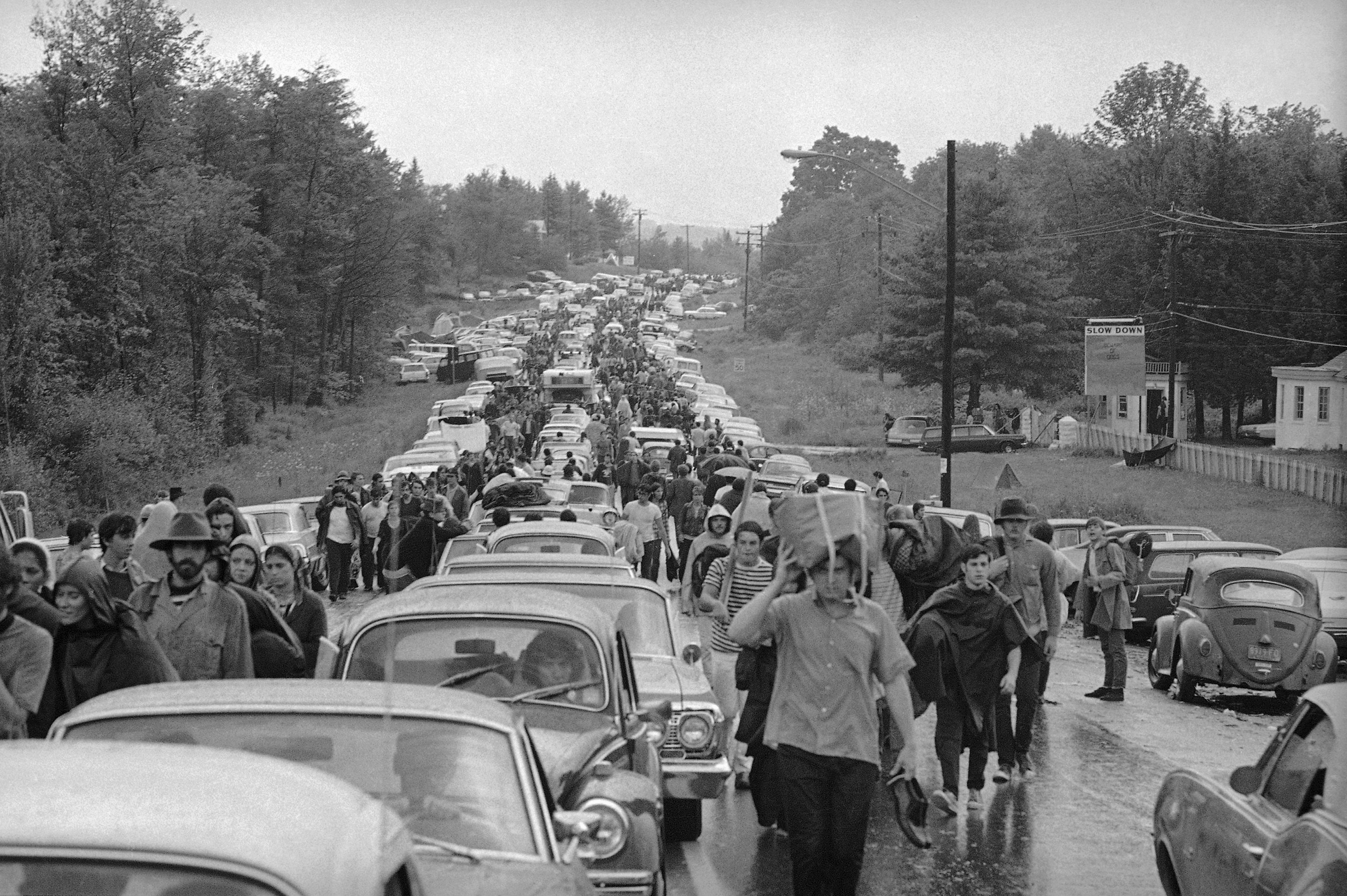 Caption: Hundreds of rock music fans jam highway leading from Bethel, New York, Aug. 16, 1969 as they try to leave the Woodstock Music and Art Festival.(AP Photo)