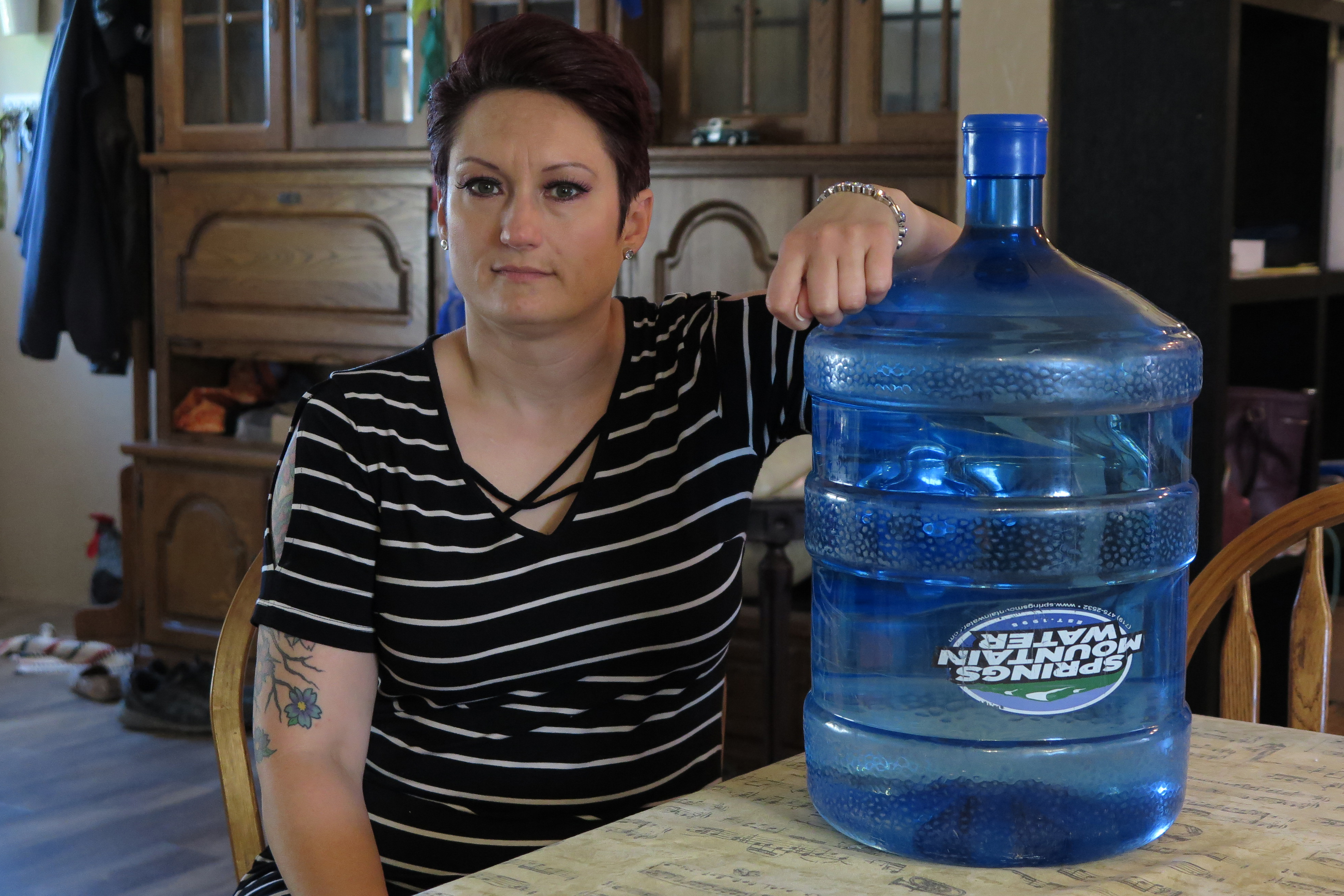 Caption: El Paso County, Col. resident Liz Rosenbaum spends about $70 per month on bottled drinking water rather than drink from her tap., Credit: Dan Boyce / American Homefront