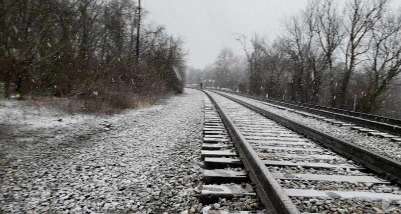 Caption: Man on tracks, Credit: Stan Smith