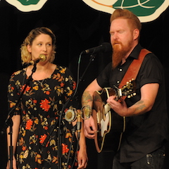 Caption: Aine O'Doherty and Danny Burns from Ireland on the WoodSongs Stage.