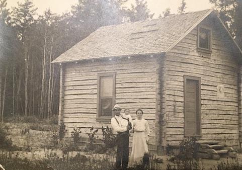 Caption: Arne Vainio's Finnish grandparents, Nestor and Amanda Vainio with their first child, Helmi, on their homestead near Sturgeon, MN. Circa 1919, Credit: Arne Vainio