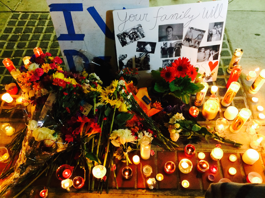 Caption: An altar in front of the Isla Vista deli where Christopher Ross Michaels-Martinez was shot in 2014., Credit: Monica Lopez