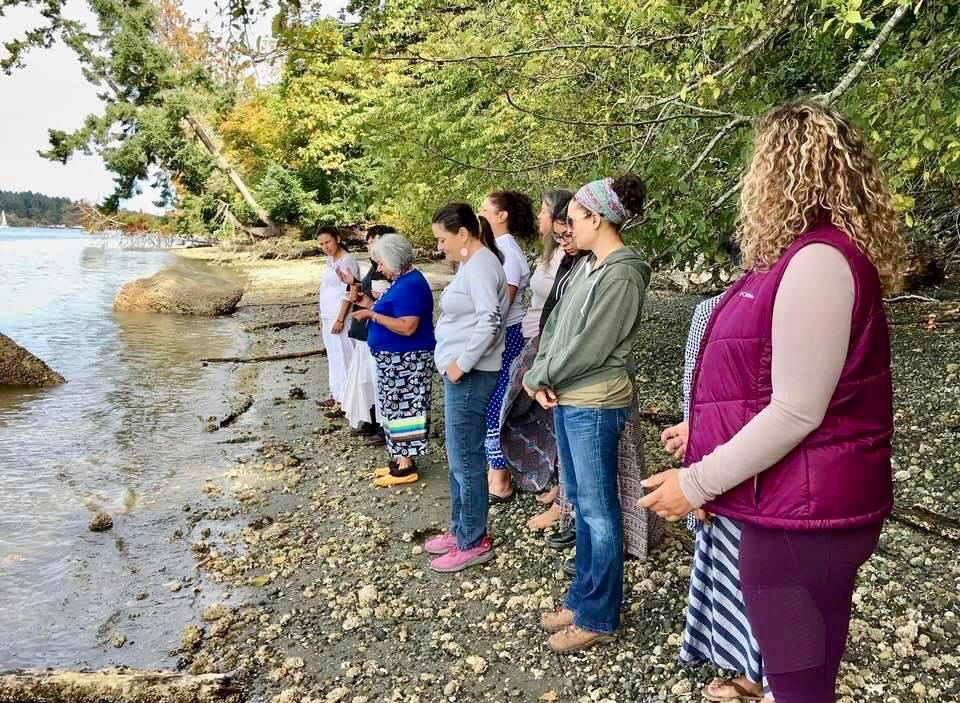 Caption: An Anishinaabe elder leads a water ceremony with women veterans, Credit: ROXANNE GOULD