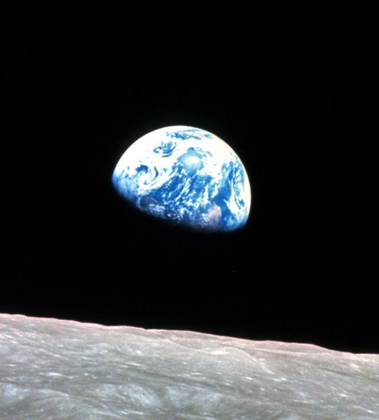 Caption: Earthrise, NASA image AS08-14-2383, taken by astronaut William Anders during the Apollo 8 mission