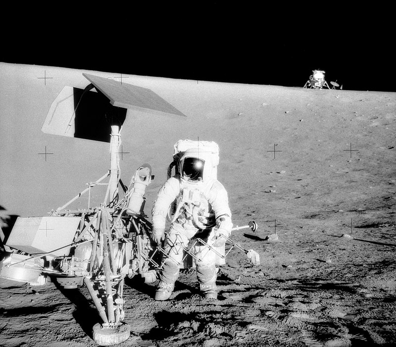 Caption: A very real image of Pete Conrad, taken by Al Bean, standing next to the Surveyor 3