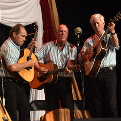Caption: The Kingston Trio on the WoodSongs Stage.