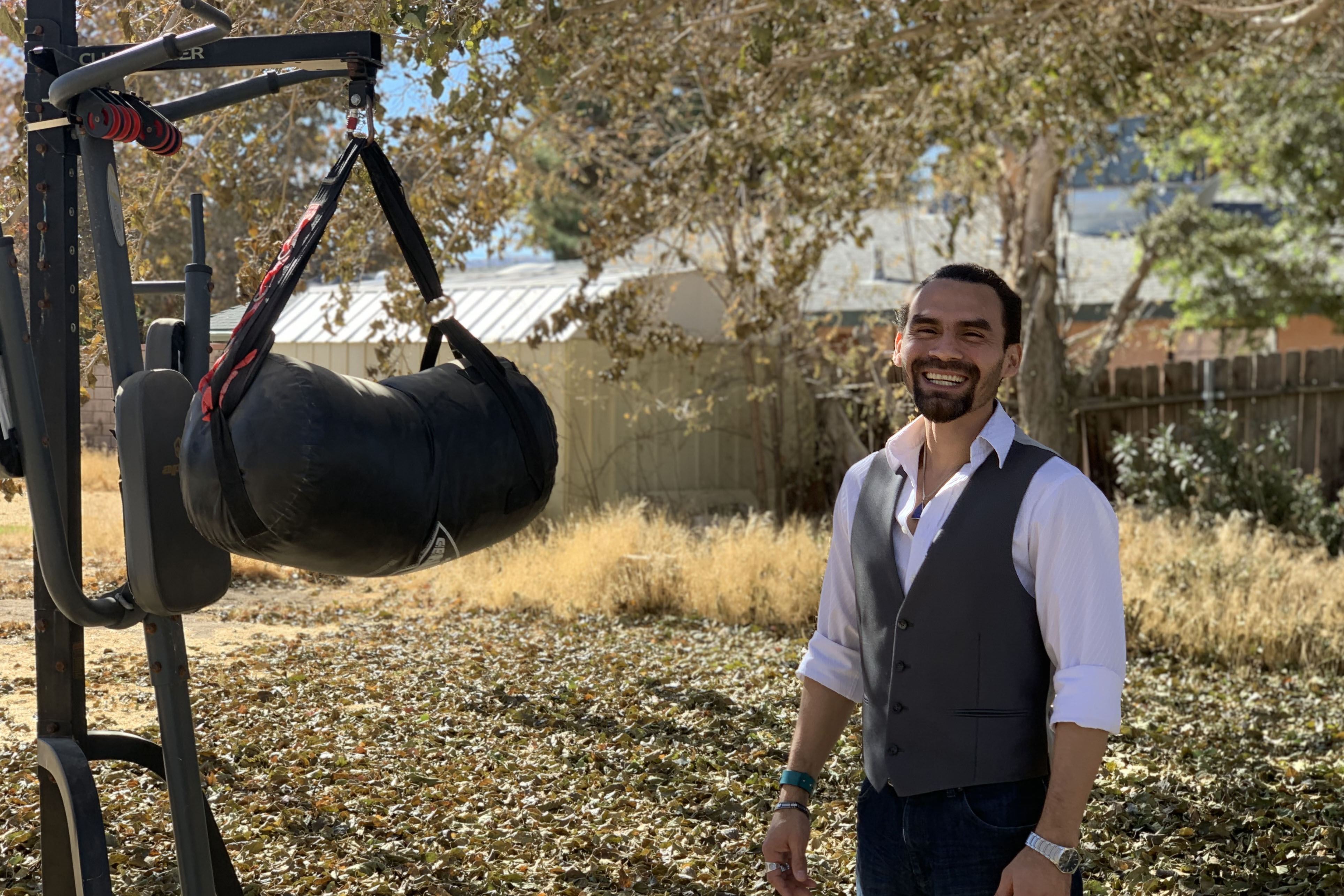 Caption: Army veteran Jesus Medina says exercising with his punching bag helps him release energy. Medina says he's still dealing with grief from his time in the military., Credit: Emily Elena Dugdale / American Homefront