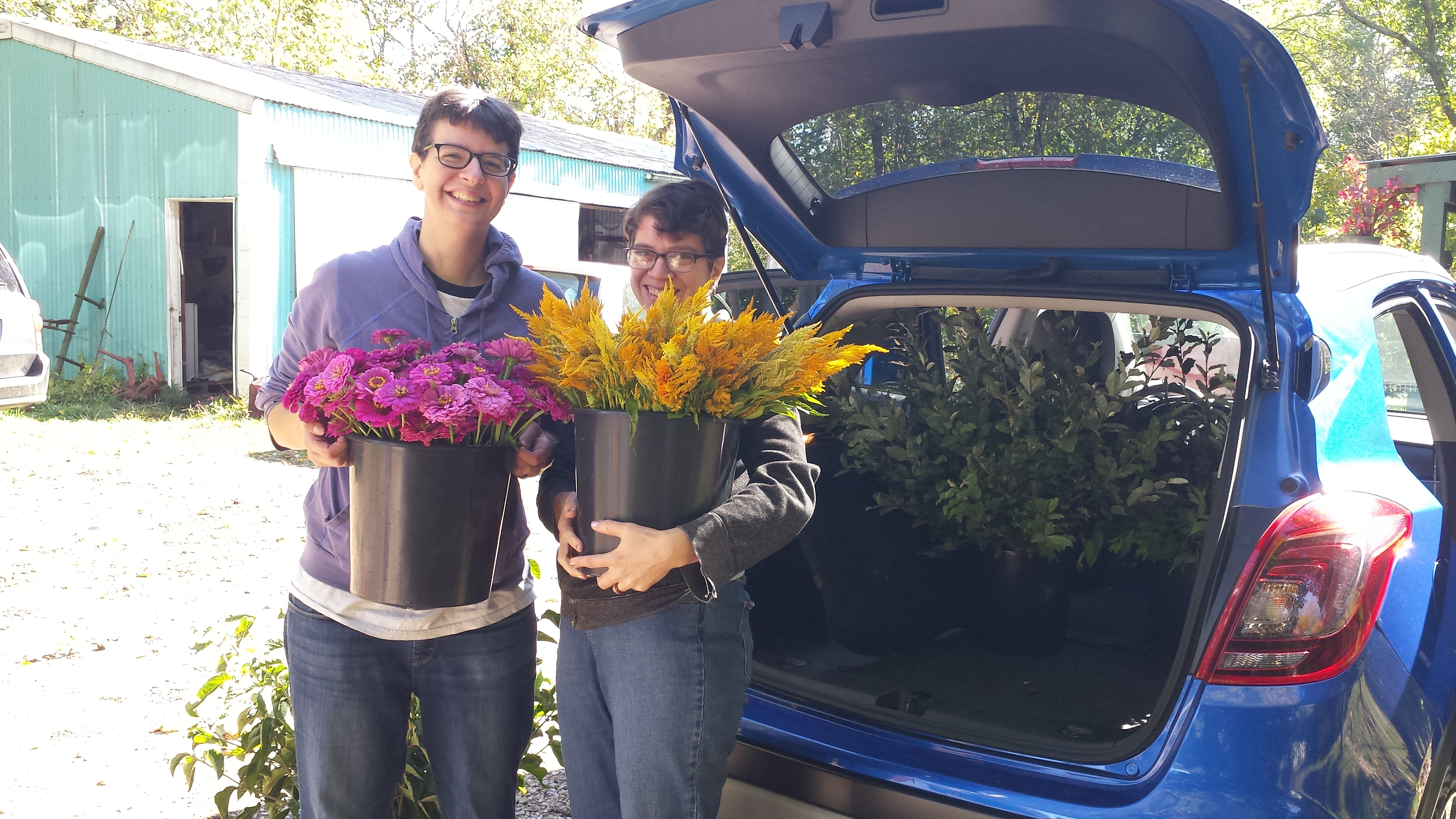 Caption: Rosalie and Katie Loading up Flowers for Their Wedding, Credit: renee wilde