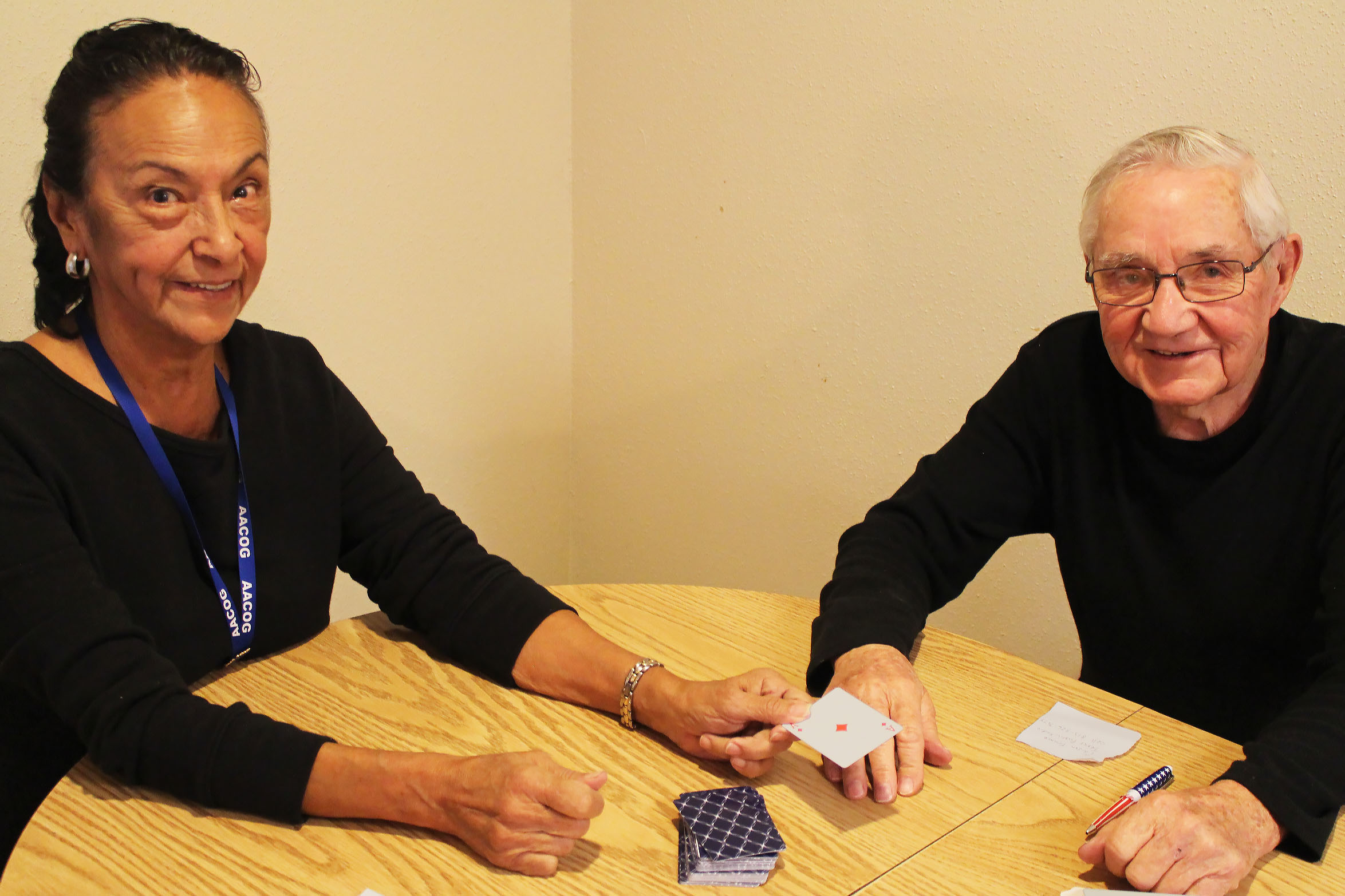 Caption: World War II veteran Gerry Bennett, 92, plays cards with Gloria Estrello, a volunteer with the Choose Home Senior Corps program., Credit: Carson Frame/American Homefront