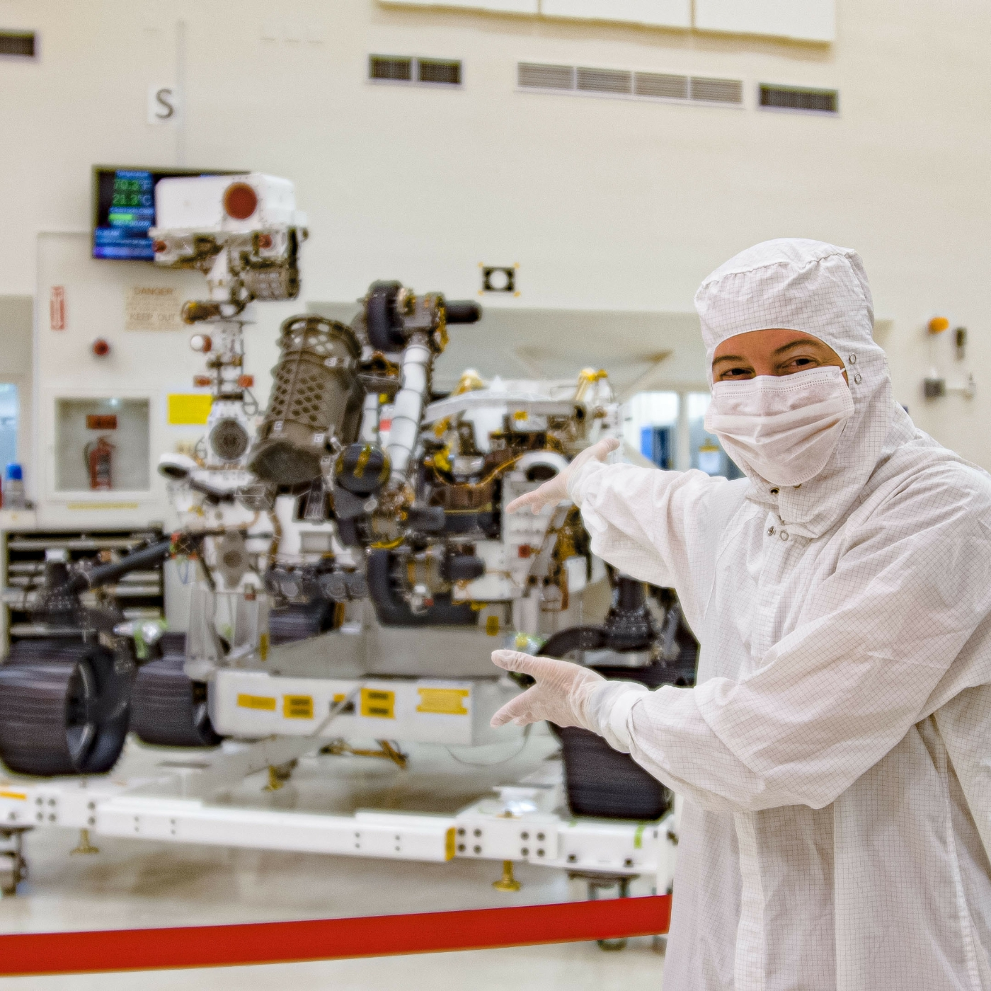 Caption: Planetary Society solar system specialist Emily Lakdawalla visits the Mars 2020 rover on 27 December 2019 during a media event held at NASA's Jet Propulsion Laboratory in Pasadena, California., Credit: Father & Sun Productions/The Planetary Society