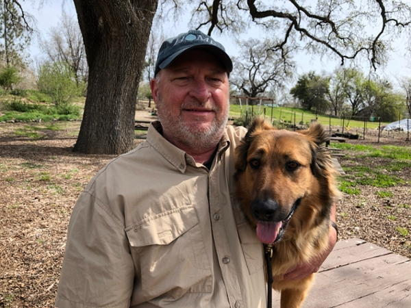Caption: Dave and his rescue dog, Ellie.