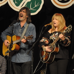 Caption: Larry Campbell and Teresa Williams on the WoodSongs Stage.