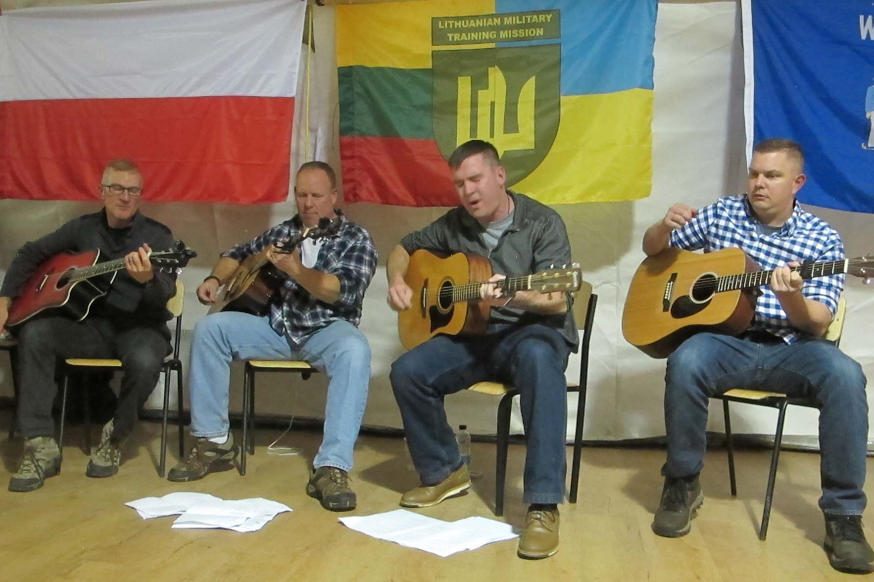 Caption: American soldiers from the Wisconsin National Guard play blues songs for a contingent of soldiers from Poland and Lithuania who are also helping train Ukraine's military., Credit: Levi Bridges / American Homefront