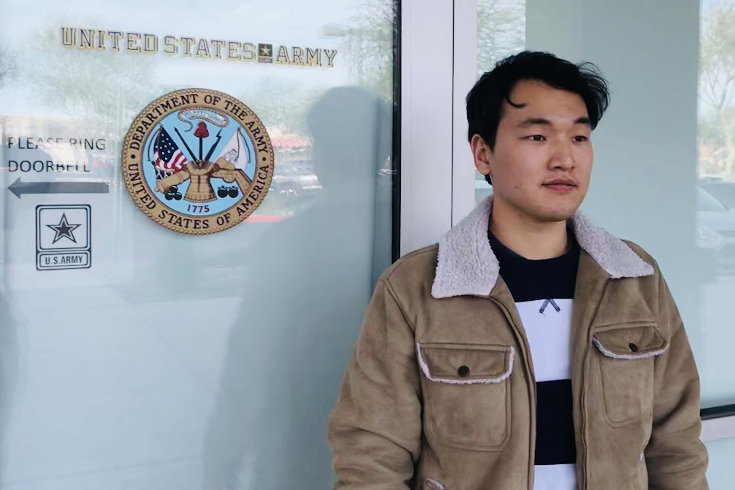 Caption: Seojun Lee stands outside an Army recruiting station near Phoenix. Lee signed up for the Army more than four years ago, but hasn't been allowed to serve., Credit: Josie Huang / American Homefront