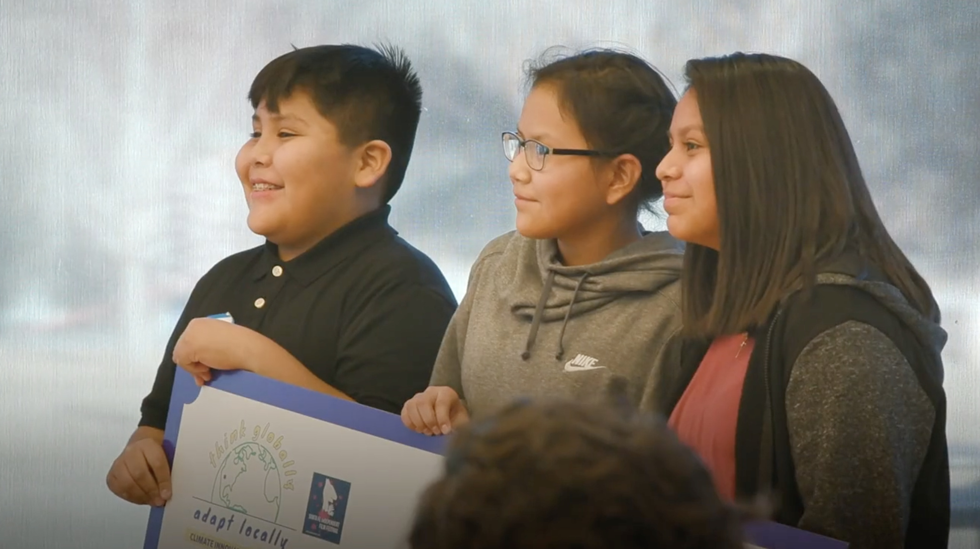Caption: Kids presenting adaptation ideas at a CAVU - Climate Advocacy Vocas Unidas event , Credit: CAVU