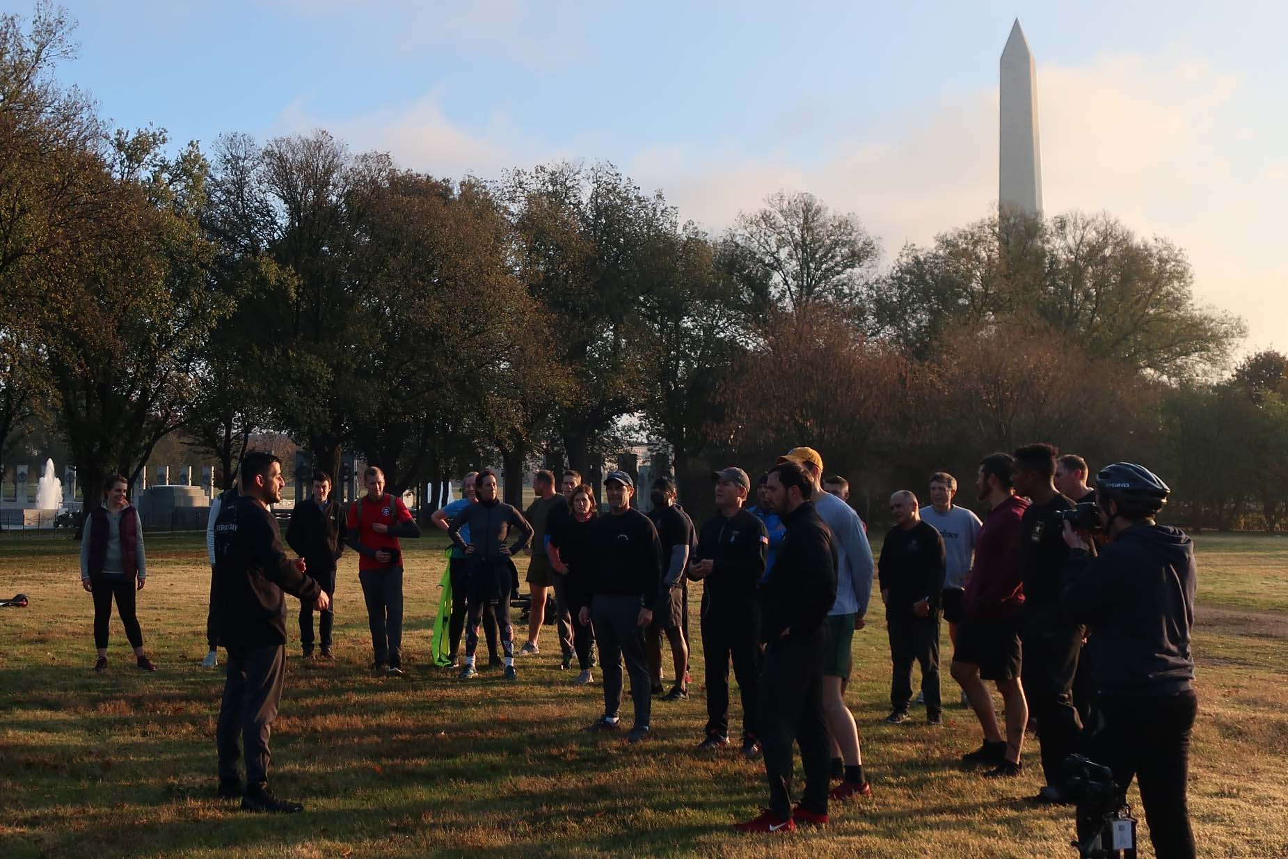 Caption: Michael Rodriguez, left foreground, president of a group that wants to build a 'Global War on Terrorism' memorial, shows the proposed site to several supporters after a Nov. 2019 sunrise run on the National Mall., Credit: Caitlin Kim / Colorado Public Radio