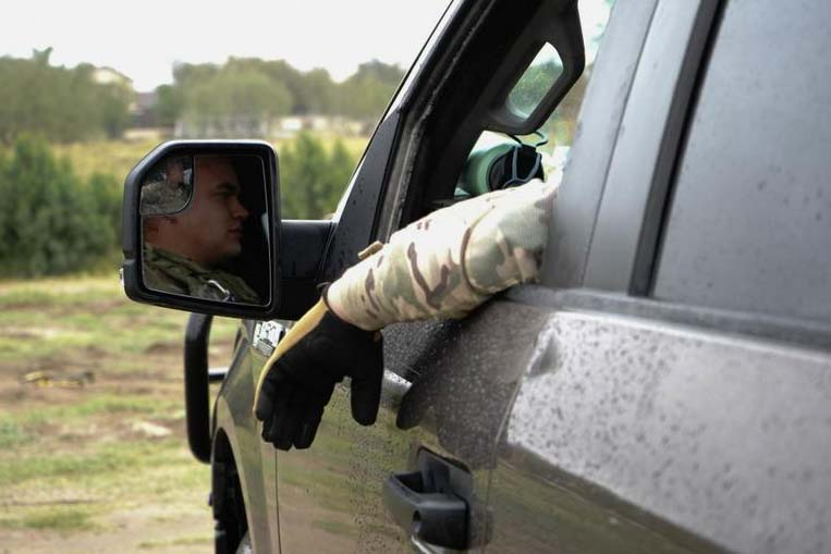 Caption: National Guard Specialist Joshua Smoak, a camera operator, sits inside a Mobile Video Surveillance System Truck in Rio Grande City, Texas., Credit:  DeJon WIlliams / Texas Air National Guard