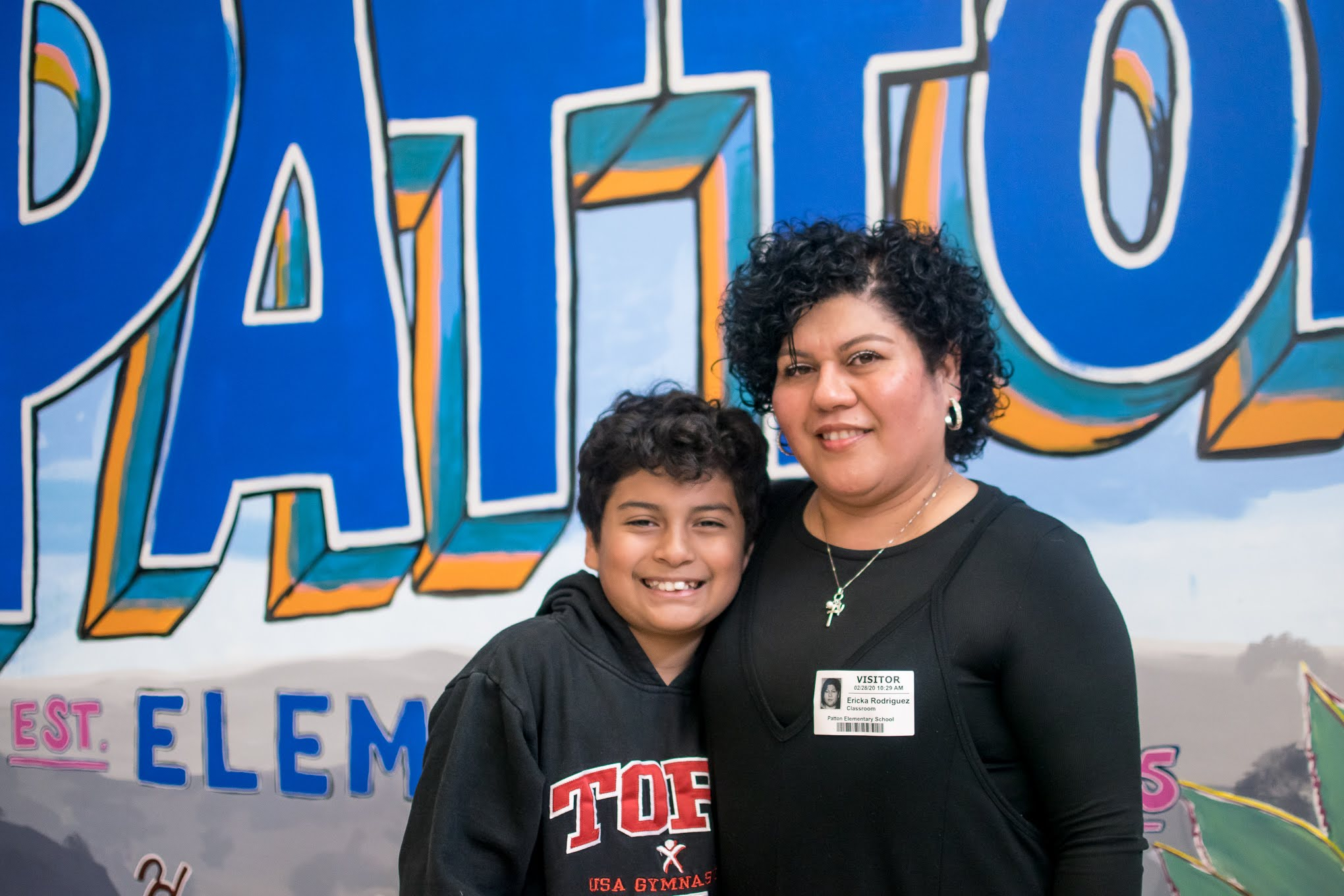 Caption: Joshua Rodriguez and his mother at Patton Elementary School, Credit: Danielle Warner