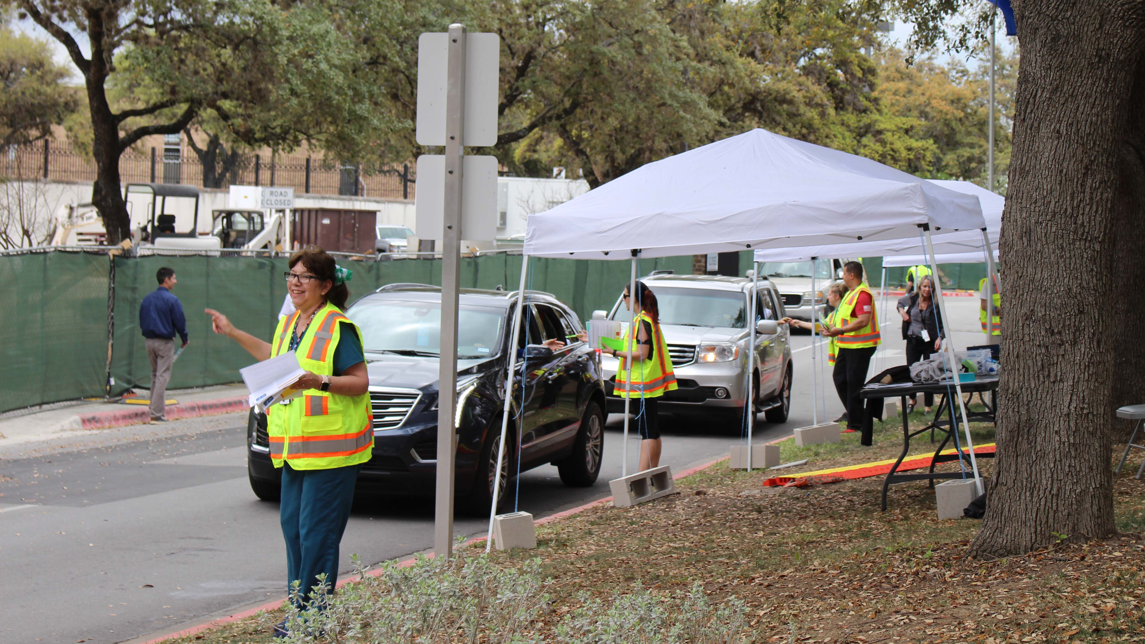 Caption: VA staff and volunteers screen patients, employees, and visitors at the entrance to the Audie Murphy Memorial VA Hospital in San Antonio., Credit: Carson Frame / American Homefront