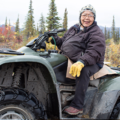 Caption: Sarah James on her four-wheeler in Arctic Village, Alaska, Credit: Amy Martin