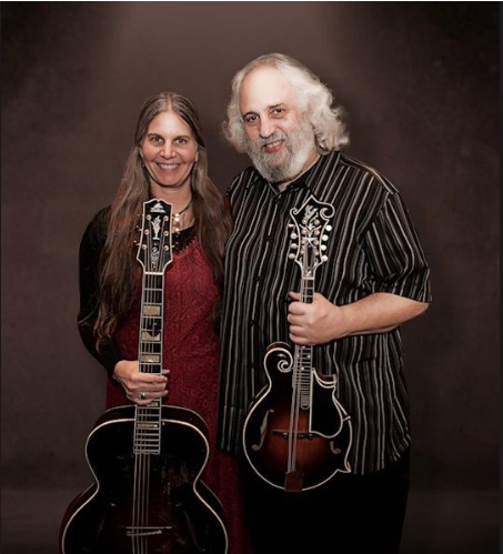Caption: David Grisman & Tracy Bigelow , Credit: - promotional photo for Goddard College benefit show, October 2018