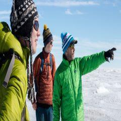 Caption: Graduate student Ian MacDowell, undergrad Aidan Stansberry, and principal investigator Joel Harper at work on the Greenland ice sheet, Credit: Amy Martin